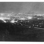View across Arcadia taken from Chantry Flats Road at night.  Long diagonal streak starting near bottom of lower right, marks Santa Anita Avenue.