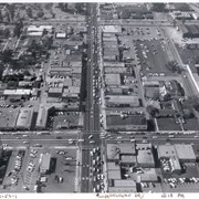 Aerial view from above Huntington Drive between Santa Anita Avenue and First Avenue.  Huntington Drive intersects the photo from north to south.  The street closest to the bottom is First Avenue and Santa Anita Avenue is near the top.